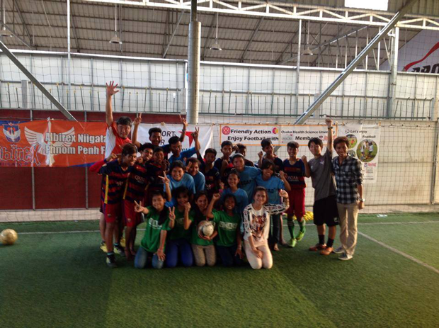 Providing balls to a football clinic for children with disabilities in Cambodia2