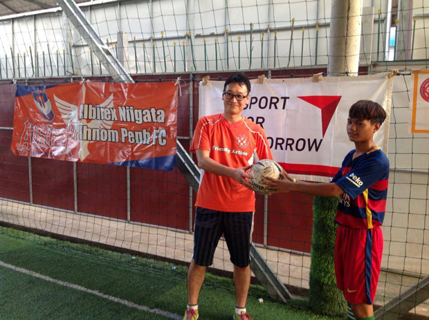 Providing balls to a football clinic for children with disabilities in Cambodia3
