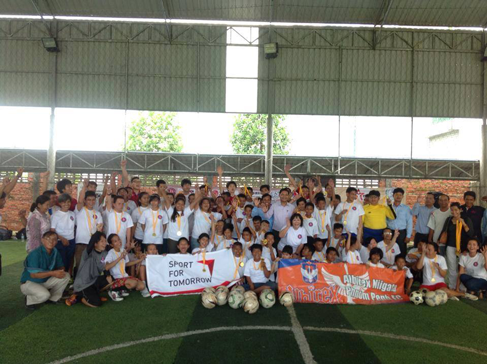 Providing balls to a football clinic for children with disabilities in Cambodia1