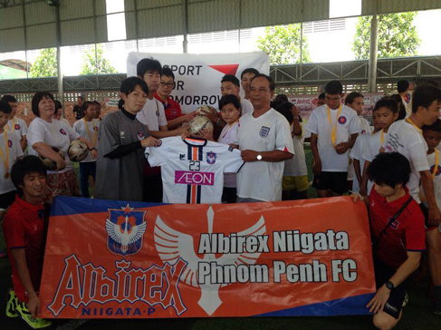 Providing balls to a football clinic for children with disabilities in Cambodia6